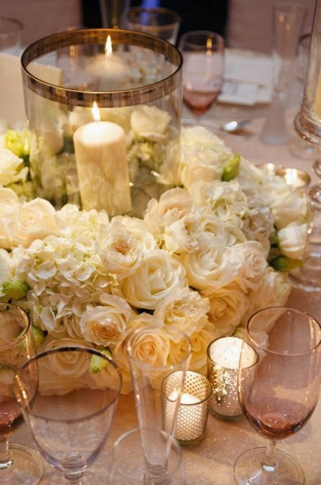 White carnations hydrangeas and roses create an exquisite