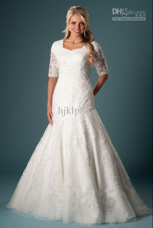Slim a line silhouette features beautiful lace appliqu for Slimming undergarments for wedding dress