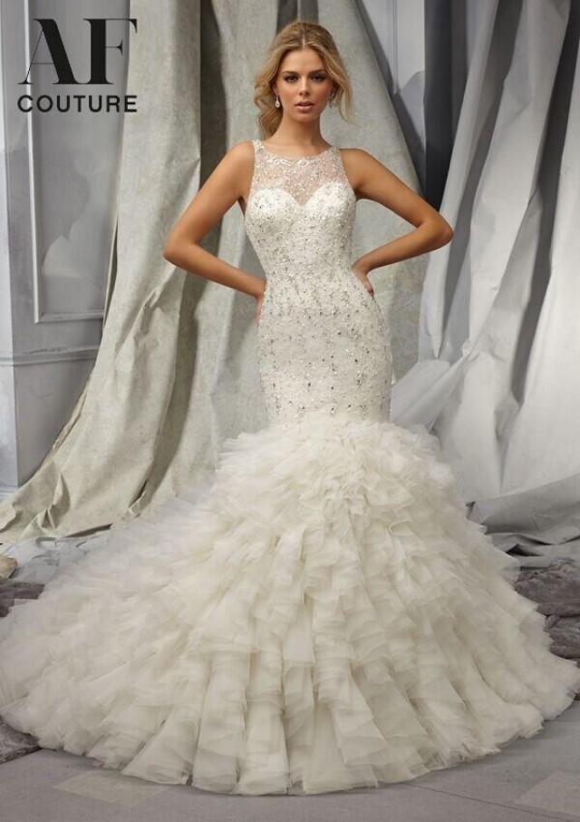 Exquisite mermaid wedding dresses 2015 heavy beaded sheer for Heavy beaded wedding dresses