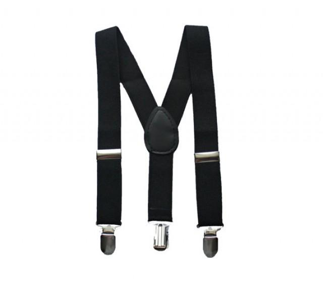 Keep up your old-school style in our Black Suspenders! These Y-back suspenders have black straps and metal clips to attach to your pants. They're adjustable too, making them the right fit for both kids .