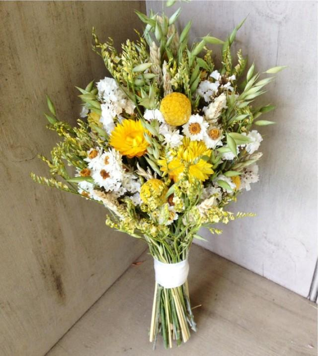 simple fall bridal bouquet of wheat craspedia and dried