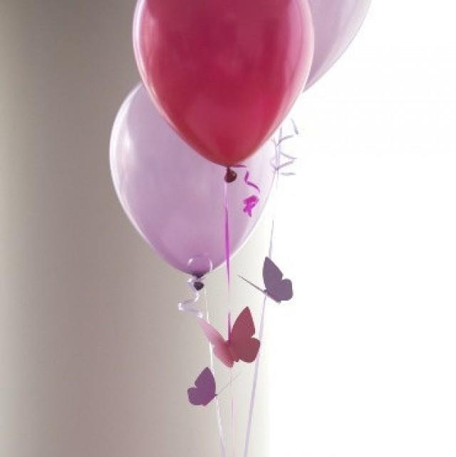 Butterfly themed birthday party decorations flying