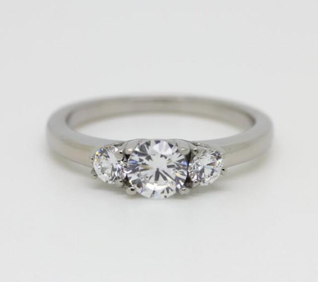 Natural White Sapphire Trilogy Ring Available In White Gold Titanium Eng