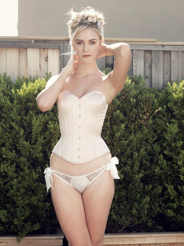sexy blonde pleasuring herself