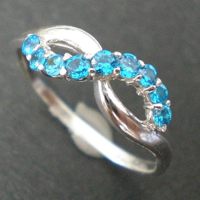 gorgeous knot infinity promise ring aquamarine blue cz