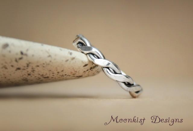 Eternity wedding band in sterling hand forged twisted for A decoration that is twisted intertwined or curled