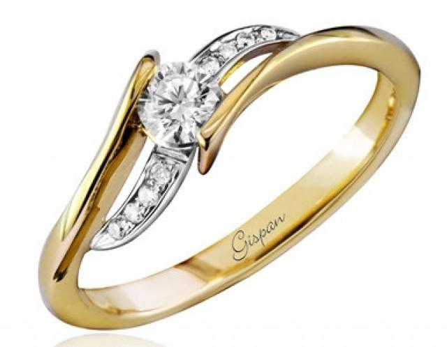 twist engagement ring yellow gold with diamonds in prong