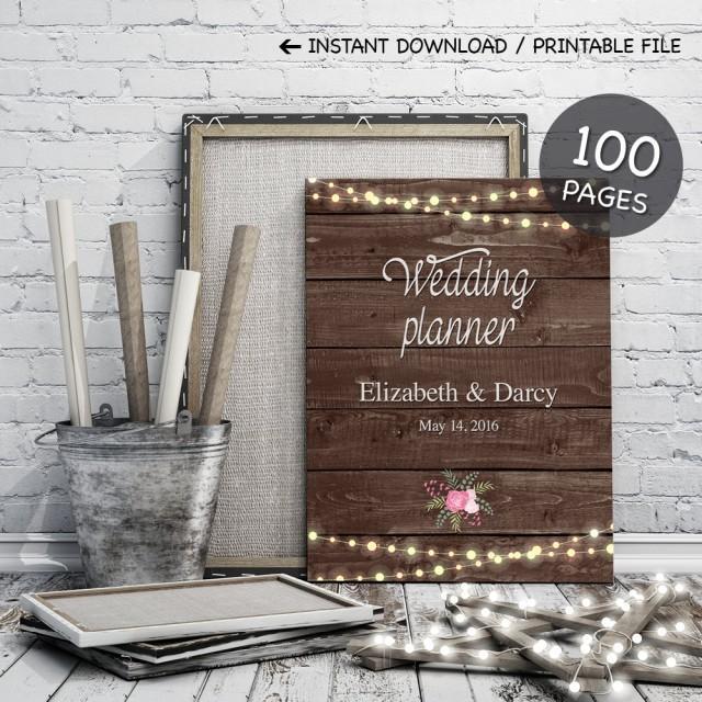 printable wedding planner on rustic wood background