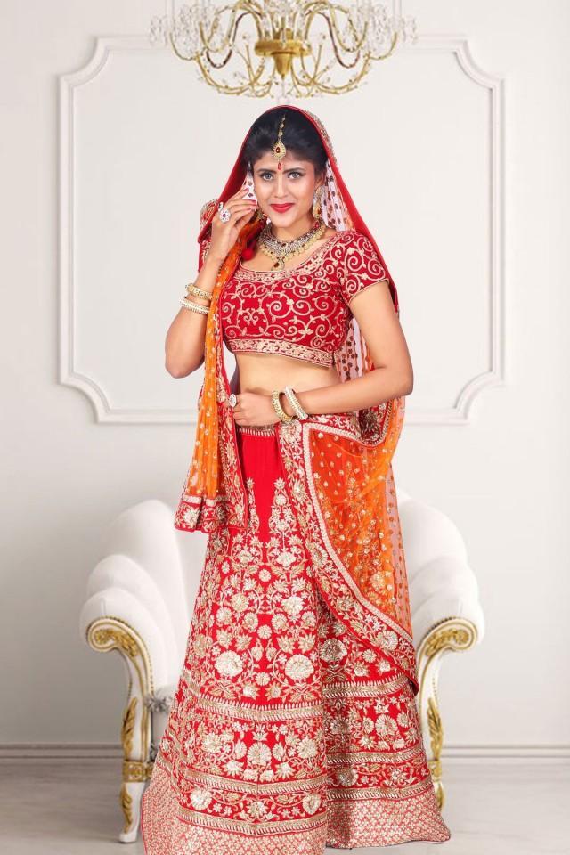 wedding photo - Red velvet flared lehenga with red velvet choli