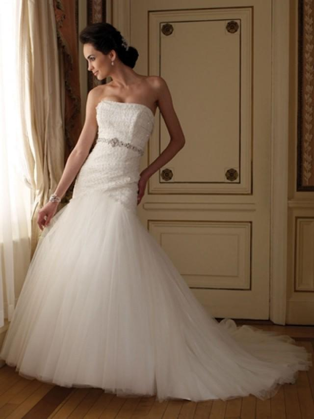 Hand beaded strapless tulle and lace modified a line for Hand beaded wedding dresses