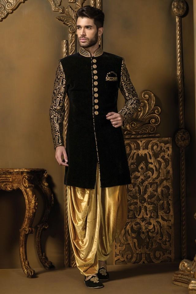 wedding photo - Black & gold velvet alluring sherwani