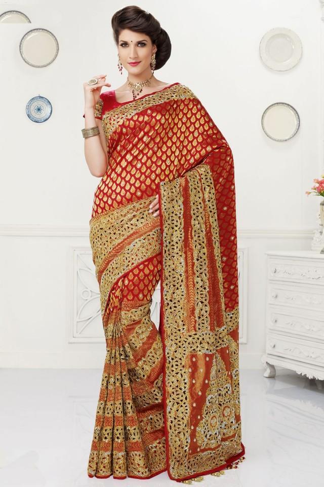 wedding photo - Red pure silk glamorous zari weaved saree with gold border