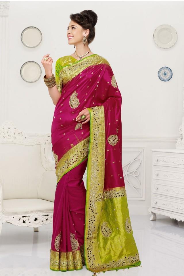wedding photo - Magenta pure silk zari weaved ravishing saree with light yellowish green & gold border