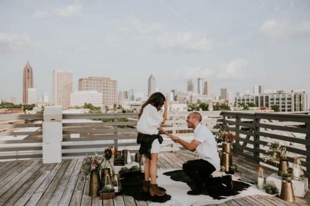 wedding photo - Modern Rooftop Proposal Overlooking The Atlanta Skyline
