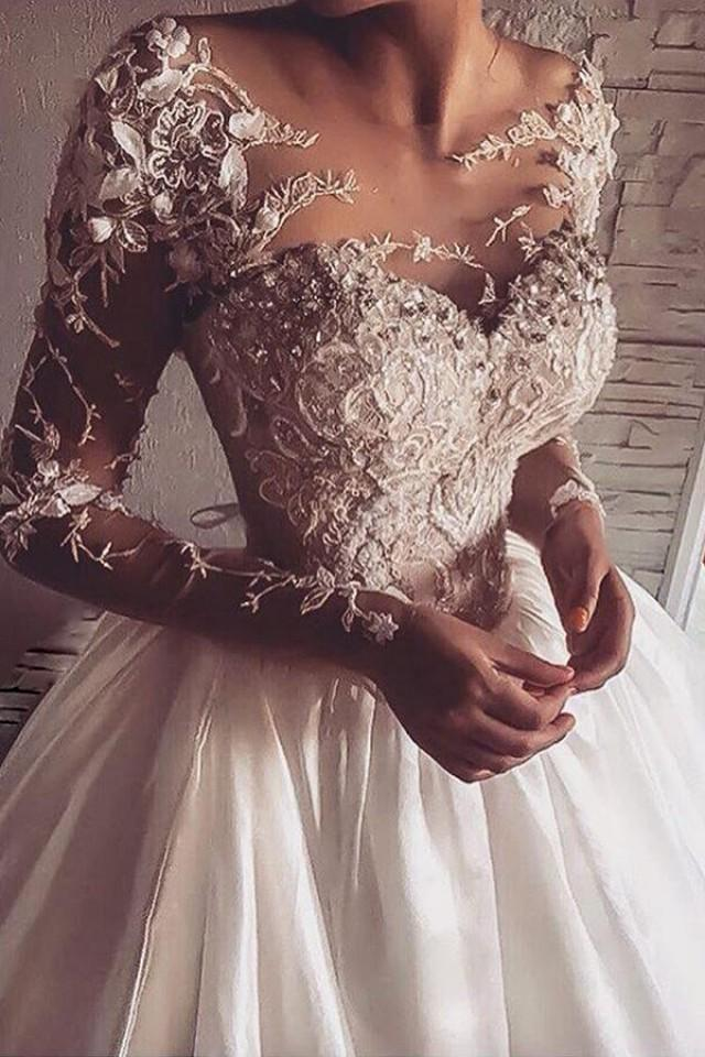 wedding photo - Goegeous Illusion Jewel Neck Long Sleeves Sweep Train Wedding Dress with Appliques Illusion Back