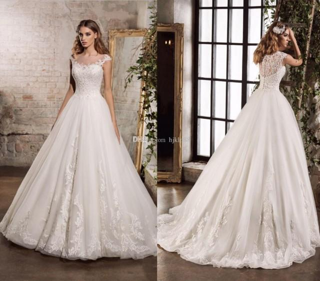 wedding photo - 2017 New Bateau Sheer Neck Lace Wedding Dresses Applique Beads Tulle Bridal Gowns A-Line Garden Wedding Dress Zipper Lace Luxury Illusion Online with $165.72/Piece on Hjklp88's Store