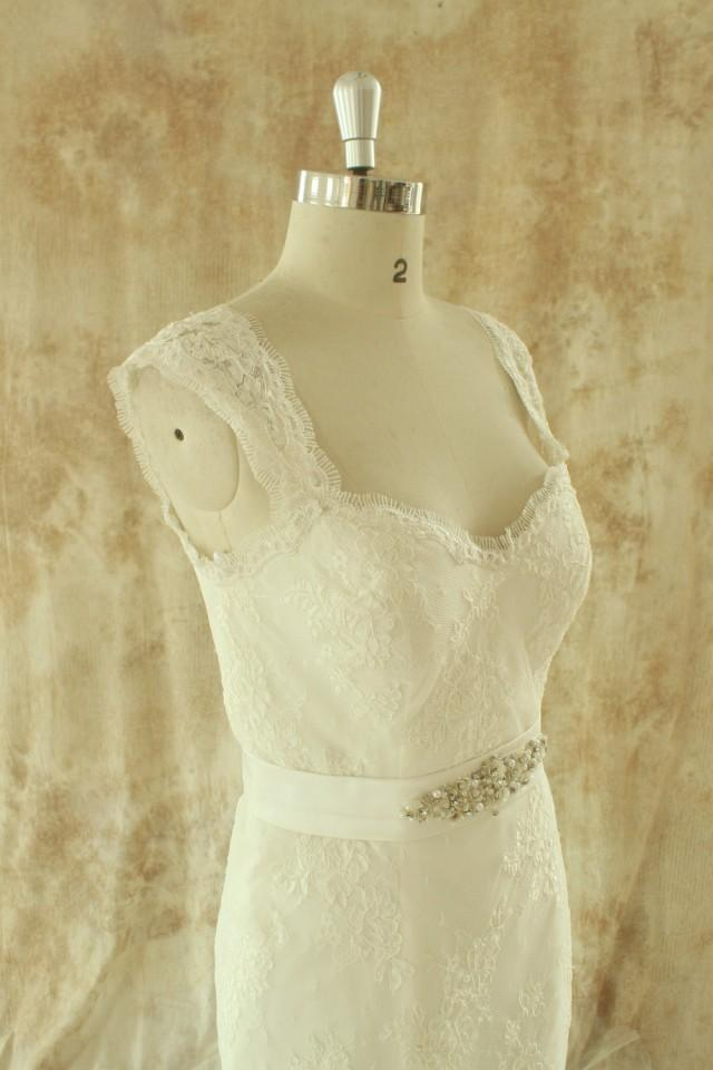 Dual straps fit and flare lace wedding dress with elegant beading sash