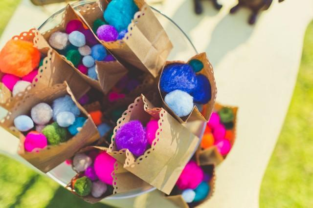 Toss colorful pom-poms instead of rice after your ceremony
