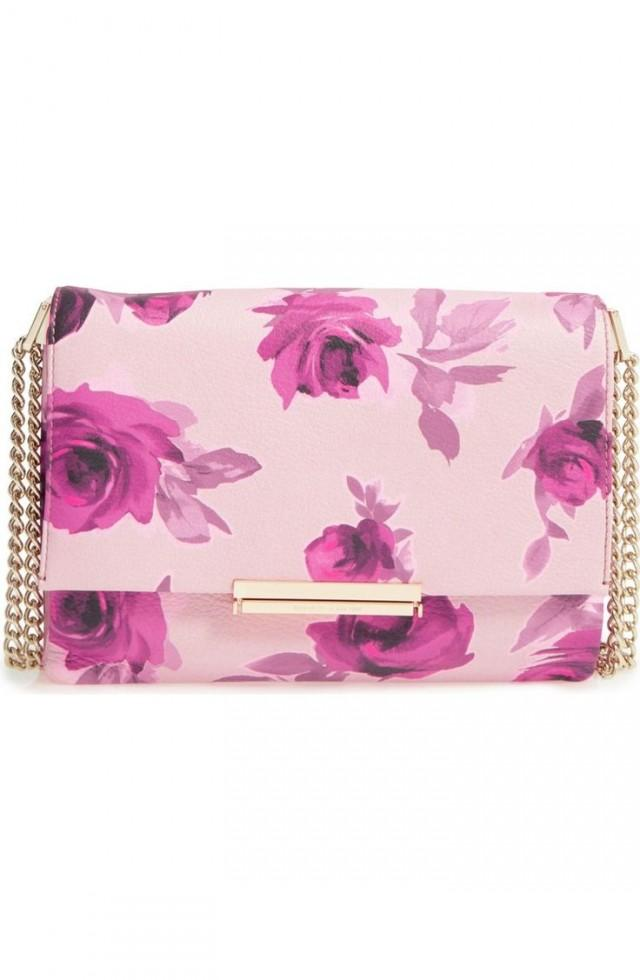 Vibrant Roses Add Eye-catching Sophistication To This Leather Shoulder Bag Suspended From A Gleaming Pull-through Chain Strap That Makes It Easy To…