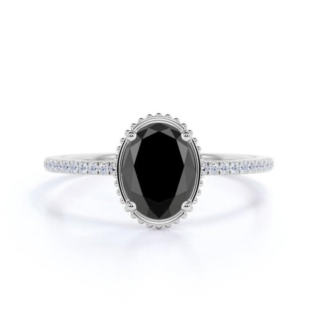 wedding photo - Attractive 1.50 Carat Black And White Diamond Halo Ring