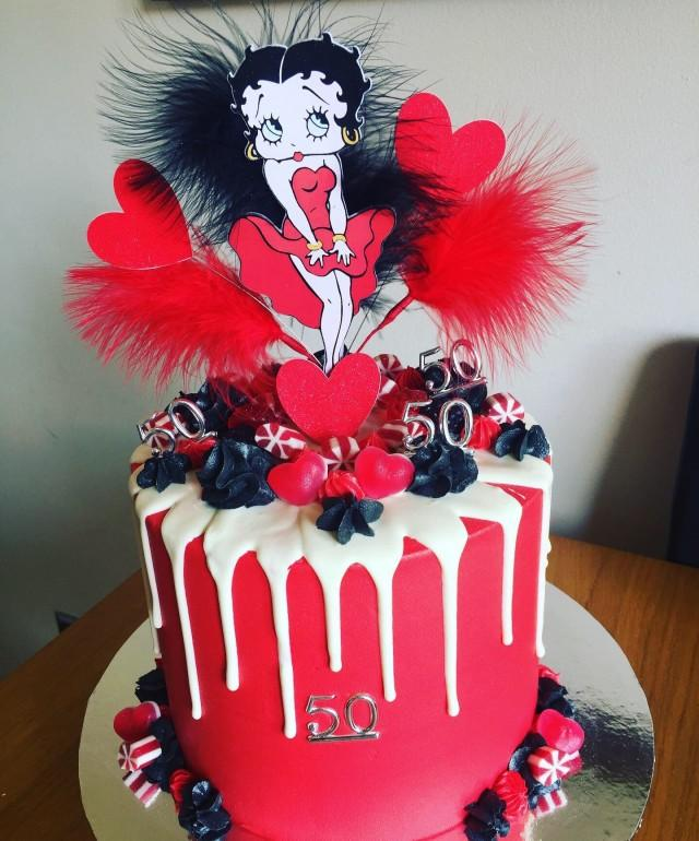 Betty Boop with feathers Birthday cake topper in pick, Betty boop display