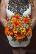 A gas mask-erade wedding fit for the impending zombie apocalypse