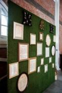 How fake grass wedding decor + picture frames = seating chart