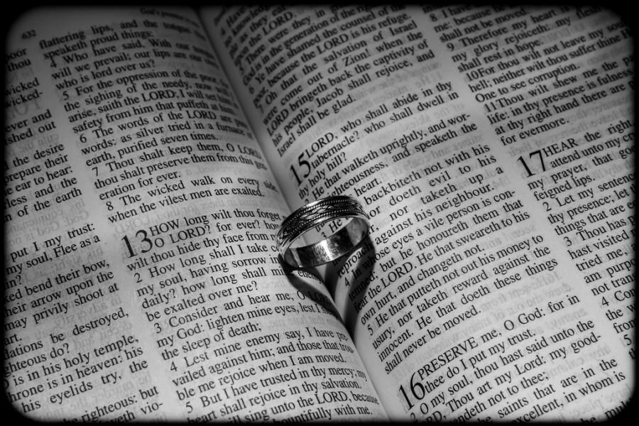 wedding rings wedding ring on bible b w 1946227 weddbook