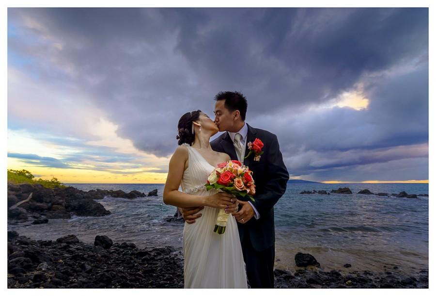 Wedding - a wedding kiss in maui