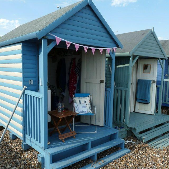 Nail beach hut and bunting 2031509 weddbook for Beach hut design ideas