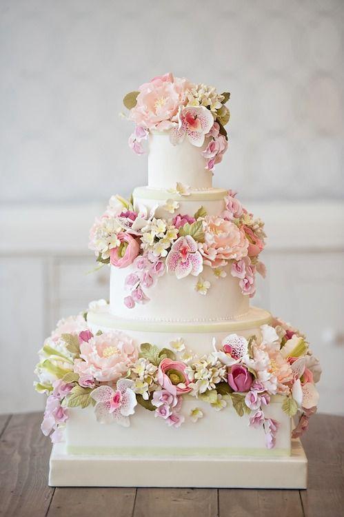 Wedding Cake With Light Colored Blossoms All Around 2050688 Weddbook