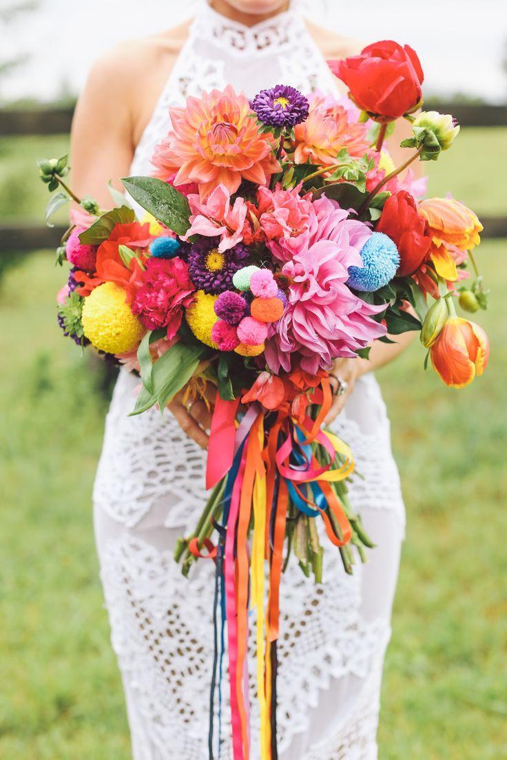 bohemian wedding colorful blossoms on the wedding aisle