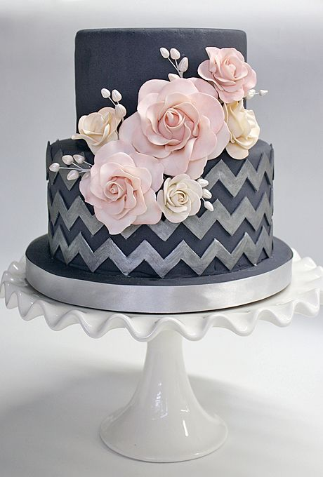 A Blue Wedding Cake With Silver Chevron Two Tiers With Pink