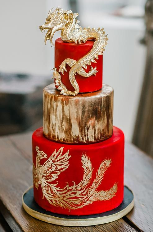 This Dramatic Wedding Cake, Topped With A Dragon And A Hand Painted Phoenix,  Embraces Traditional Chinese Wedding Symbol.