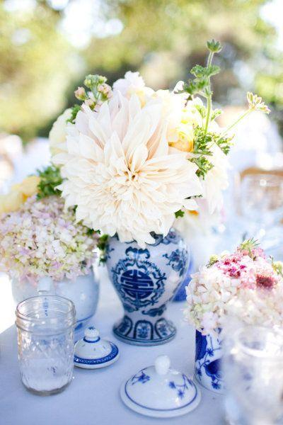 Centerpieces Of Blue And White Chinese Vases And Teapots Filled With
