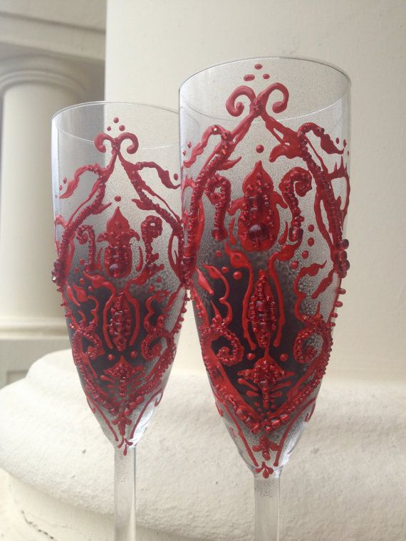 Wedding Champagne Glasses Toasting Flutes With A Dark Red Damask On