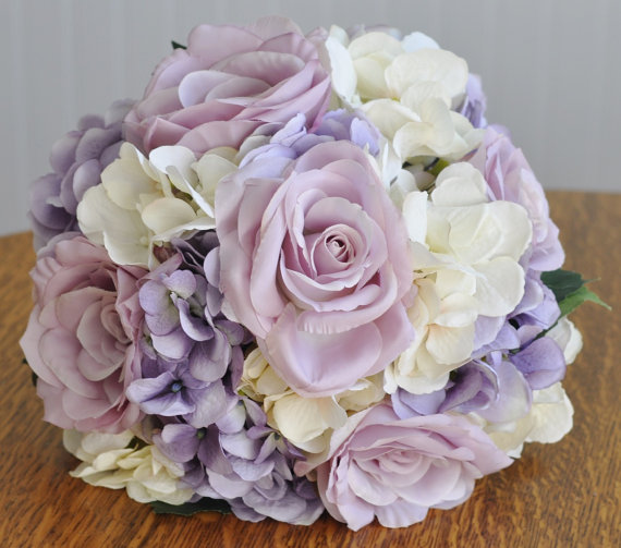 Hochzeit - Silk Wedding Flower Bouquet made with Lavender Roses, Lavender Hydrangea and Ivory Hydrangea wrapped in Champagne Ribbon.