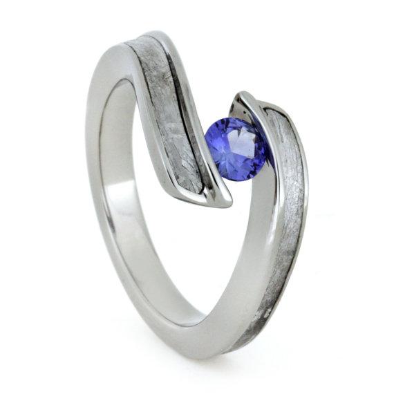 tension set blue sapphire engagement ring titanium