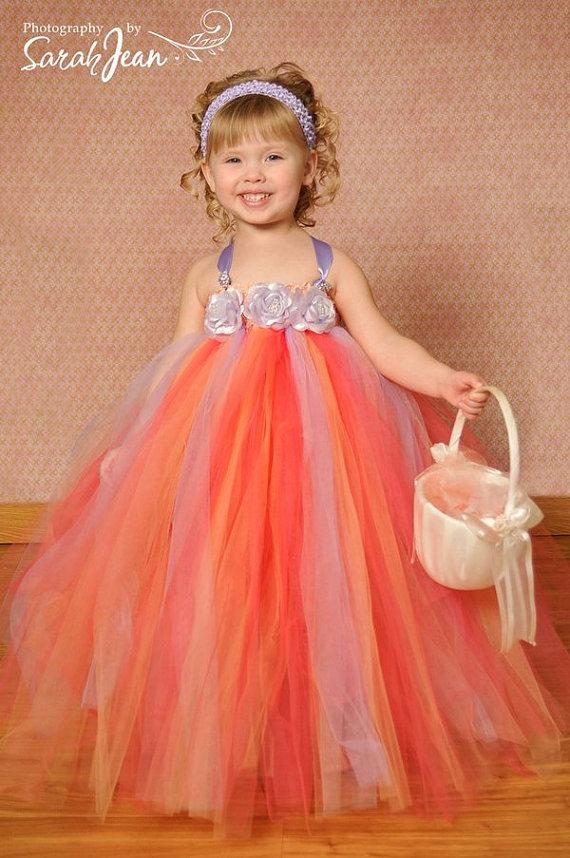 Allow baby tutus to be shining stars, standing solo in dress form. Go soft, subtle, and sweet with a creamy floral dress featuring a pastel touch. Go soft, subtle, and sweet with a creamy floral dress featuring a pastel touch.