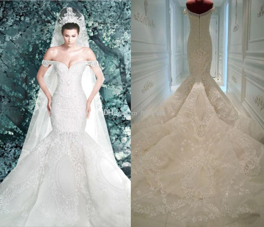 Michael cinco wedding dresses 2014 new arrival pearls lace for Mermaid off shoulder wedding dress