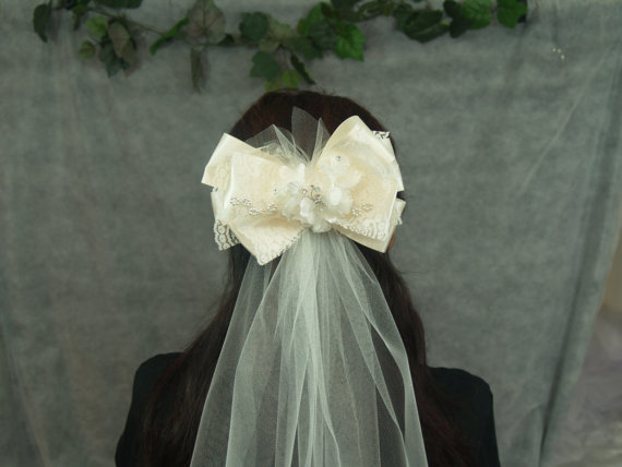 Hochzeit - Brides Ivory Veil short style with attached big bow unique style asymetrically cut tulle ribbons