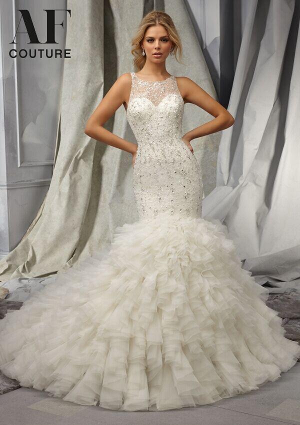 Exquisite mermaid wedding dresses 2015 heavy beaded sheer for Storing your wedding dress