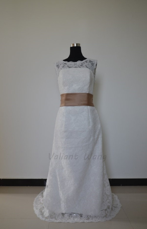 Mariage - Vintage Ivory Lace Wedding Gown Champagne Sash Decorative Buttons Deep V Back Floor Length Wedding Dress