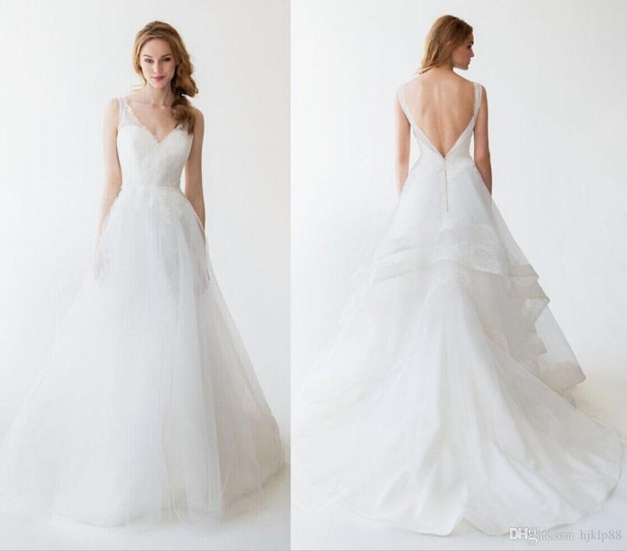 Cheap kelly faetanini wedding dresses 2015 white lace v for Lace v neck backless wedding dress