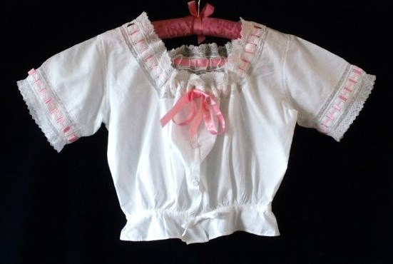 Mariage - Antique camisole, white cotton with lace, broderie-anglais and pink ribbon trim, drawstring waist, linen covered buttons. c1890-1910.