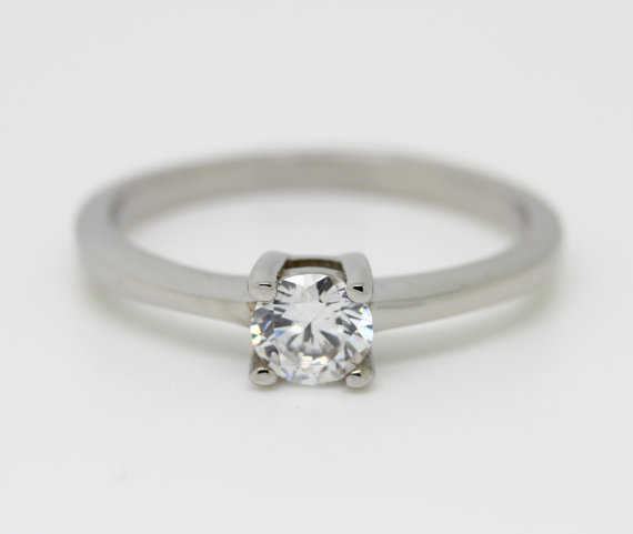 white sapphire solitaire engagement ring in white gold or