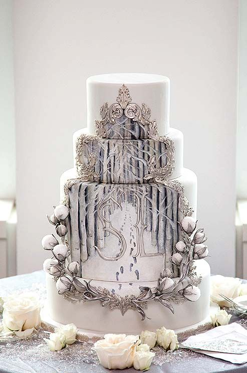 This Winter Themed Wedding Cake Features Two Sets Of Footprints