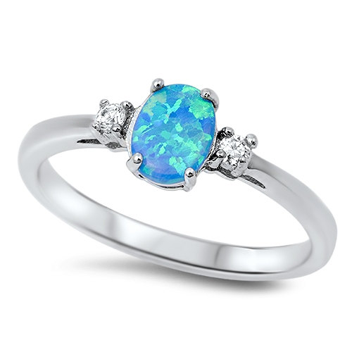 Свадьба - 0.71 Carat Oval Cut Blue Fire Australian Lab Opal 925 Sterling Silver Round Clear Topaz Infinity Band Wedding Engagement Stunning Ring