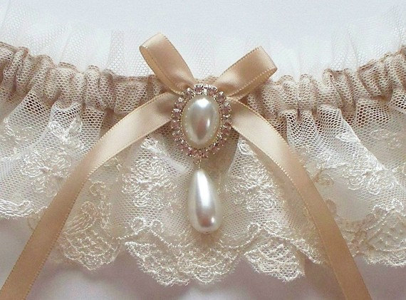 Свадьба - Wedding Garter in Ivory Lace on Champagne Band with Pearl and Crystal Detail - The MEREDITH Garter