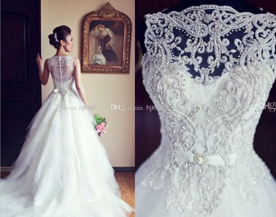 Hochzeit - 2014 A Line Wedding Dress with Sheer Straps Buttons Back Bridal Gown Embroidery Ball Gown Wedding Dresses Vestido Noiva BO3039, $119.91